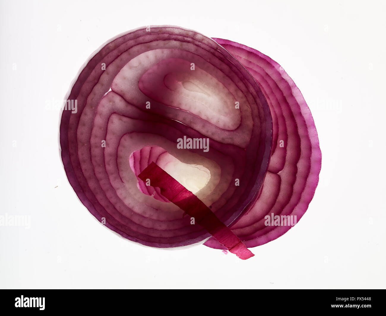 Abstract red onion slices close up food photograph - Stock Image