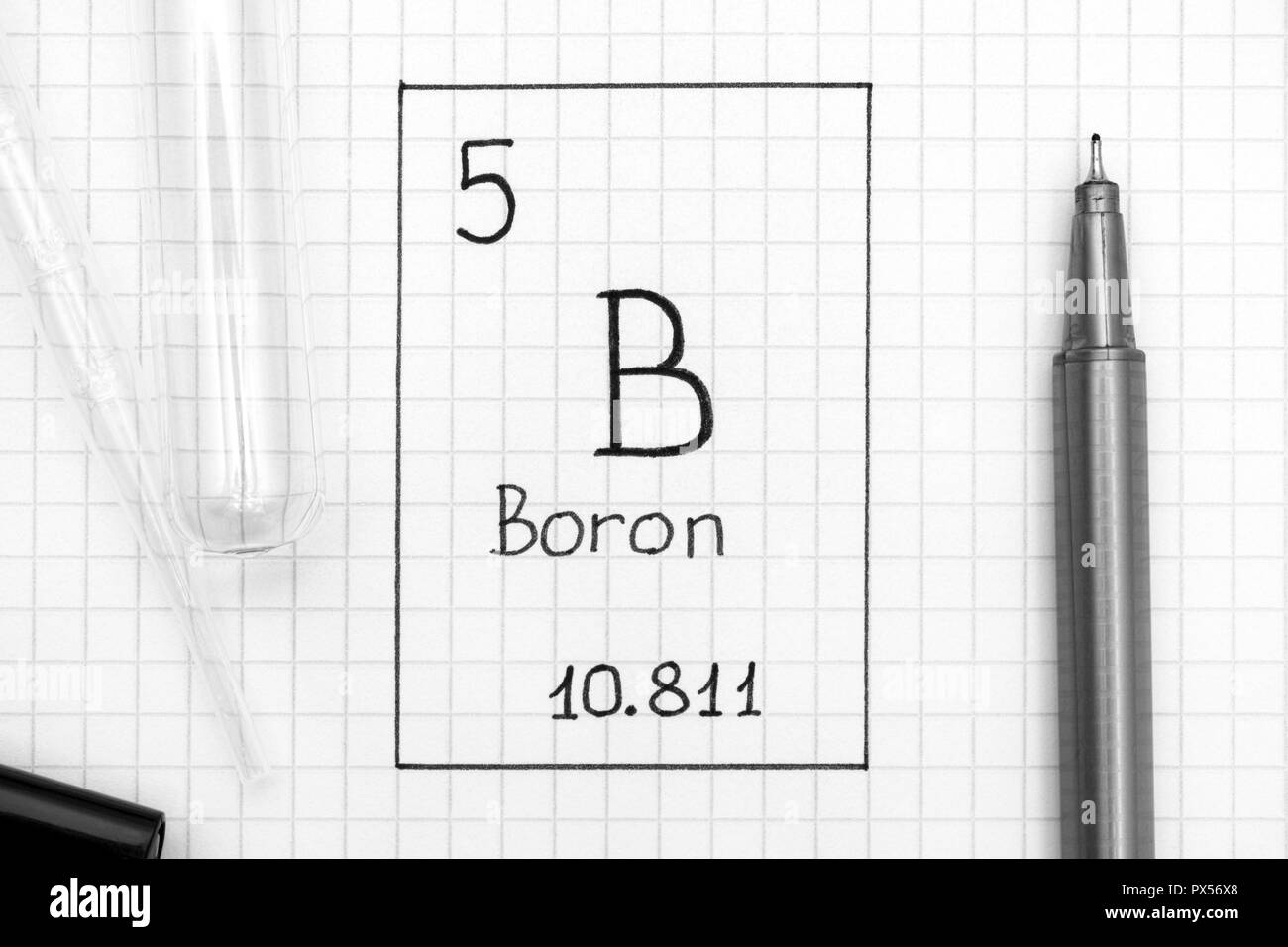 The Periodic table of elements. Handwriting chemical element Boron B with black pen, test tube and pipette. Close-up. Stock Photo