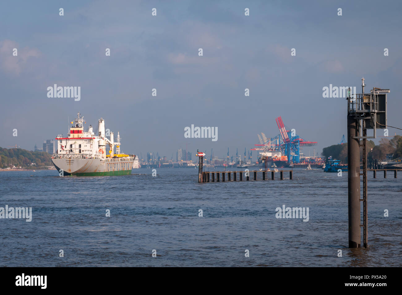Hamburg, Germany - October 20, 2014: General cargo vessel YongXing arrives in Hamburg Harbor. YongXing belongs to the chinese-polish shipping line Chi - Stock Image