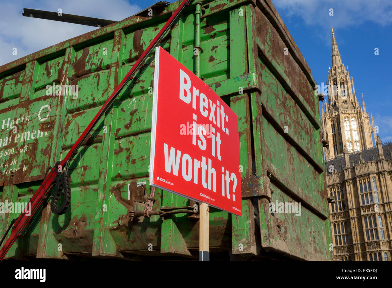 A refuse lorry passes a placard asking about the value of a Brexit, attached by pro-Europe anti-Brexit protesters to railings opposite the British Houses of Parliament in Westminster, on 16th October 2018, in London, England. Stock Photo