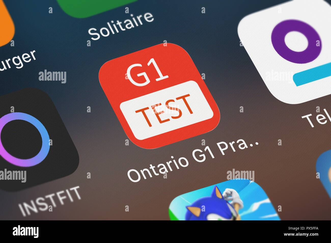 London, United Kingdom - October 19, 2018: Close-up shot of Nhu Quynh Nguyen's popular app Ontario G1 Practice Test. - Stock Image