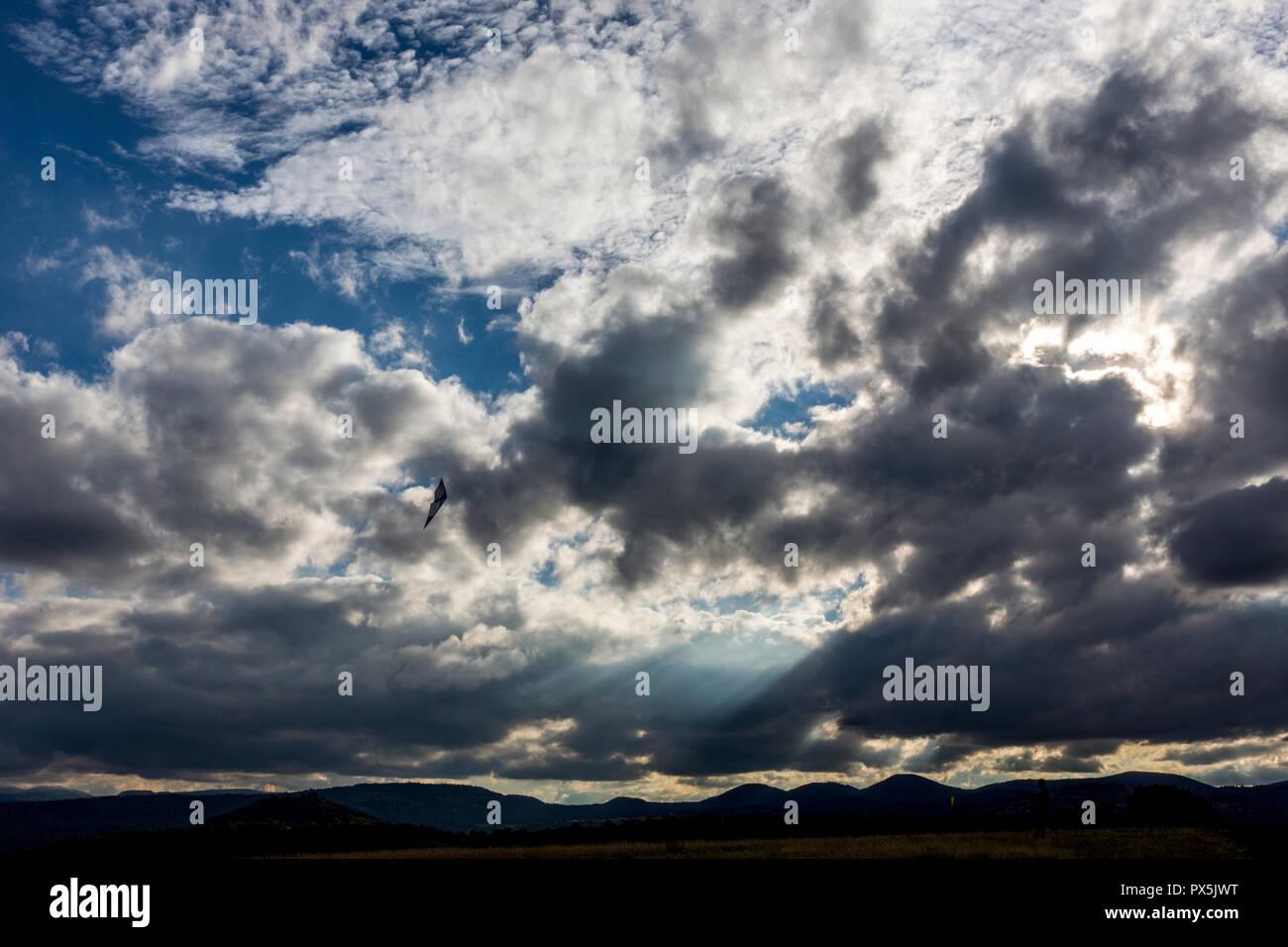 Kite flying on a cloudy evening at Plateau de Gergovie, Auvergne, France. Stock Photo