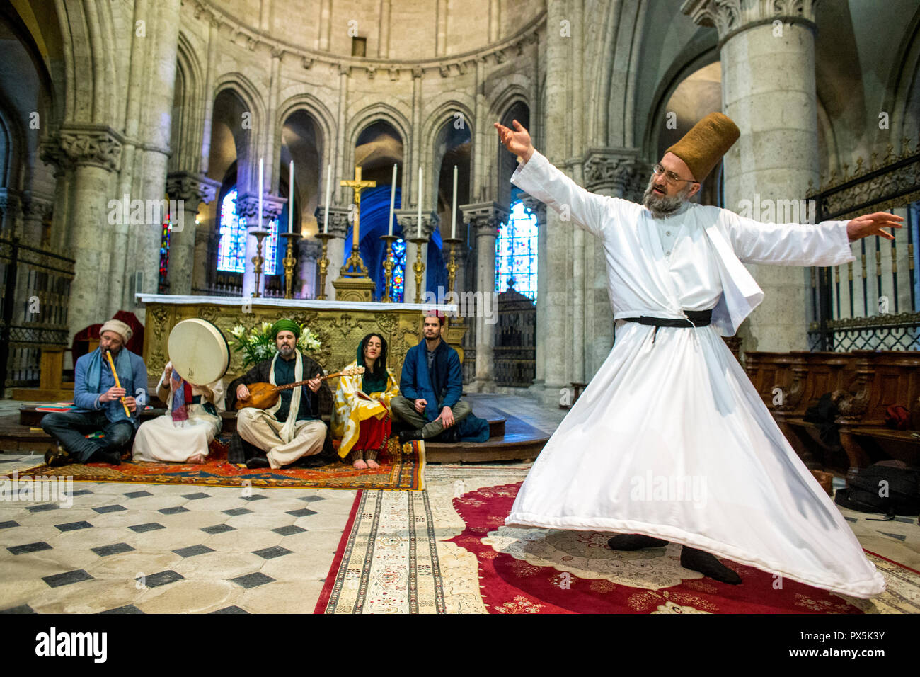 Sufi muslim wedding in St Nicolas's catholic church, Blois, France. Sufi music band and whirling dervish. - Stock Image