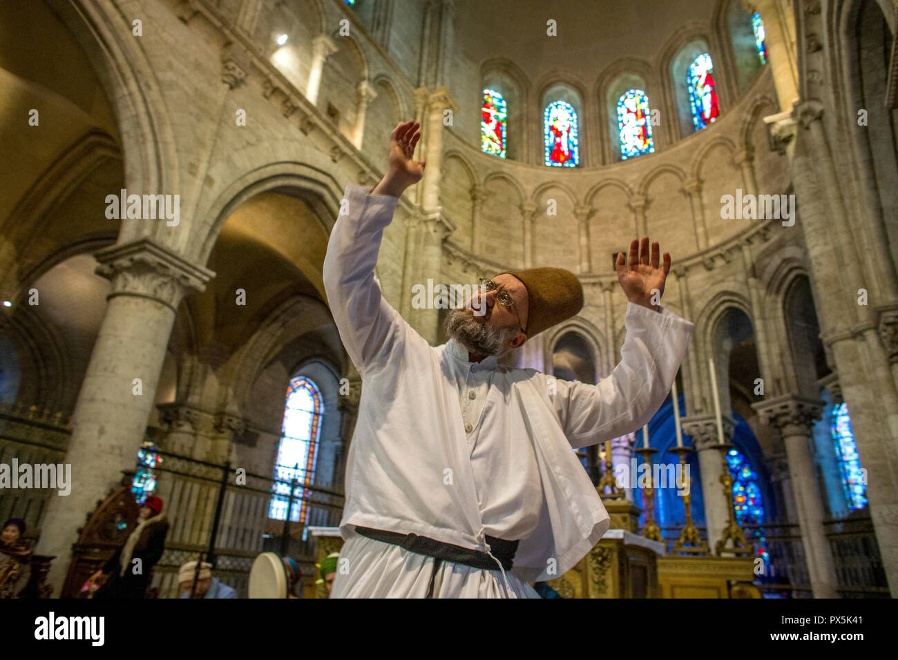 Sufi muslim wedding in St Nicolas's catholic church, Blois, France. Whirling dervish. - Stock Image