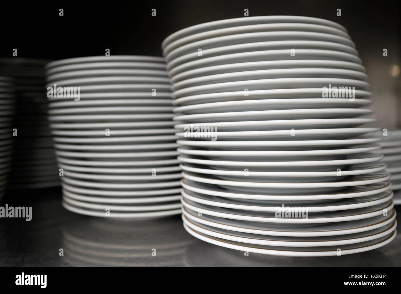 Inauguration du Casino de Saint-Gervais. 19 mai 2018.  Pile of clean ceramic white plates in a restaurant. France. - Stock Image