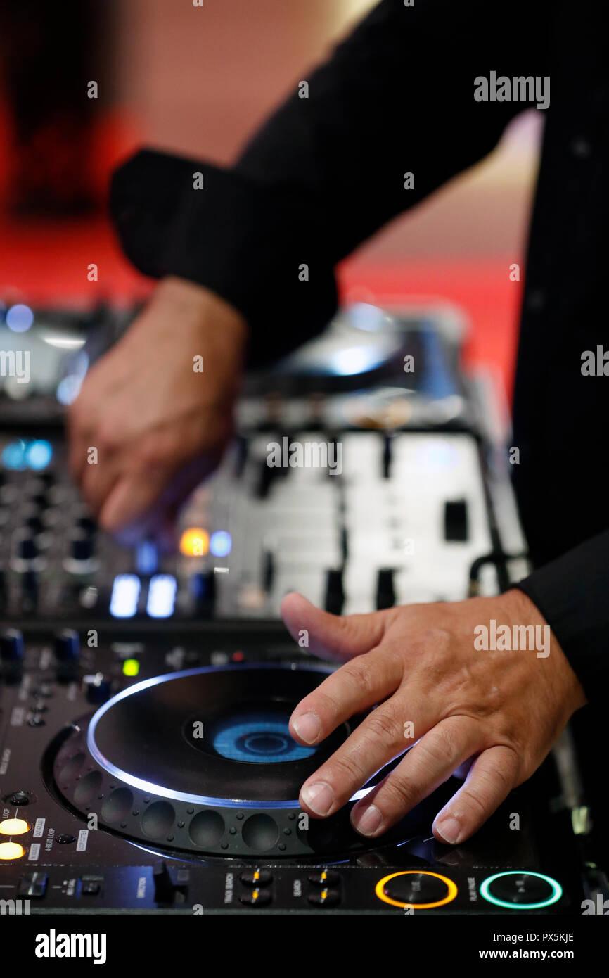 Disk jockey playing music at mixer. Close-up.  France. - Stock Image