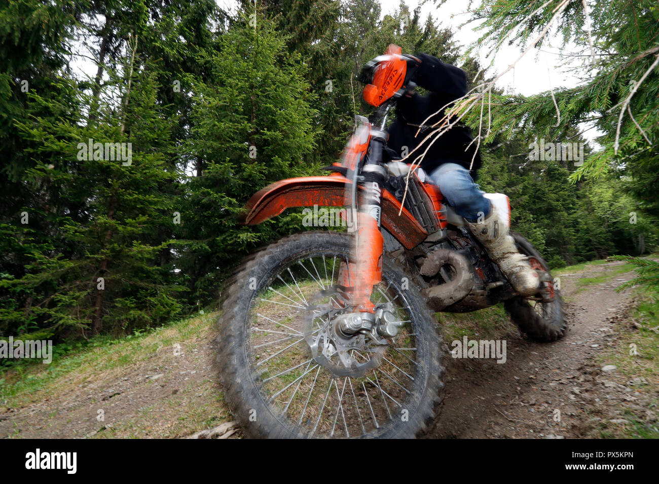 Motocross driver riding in the french Alps.  France. - Stock Image