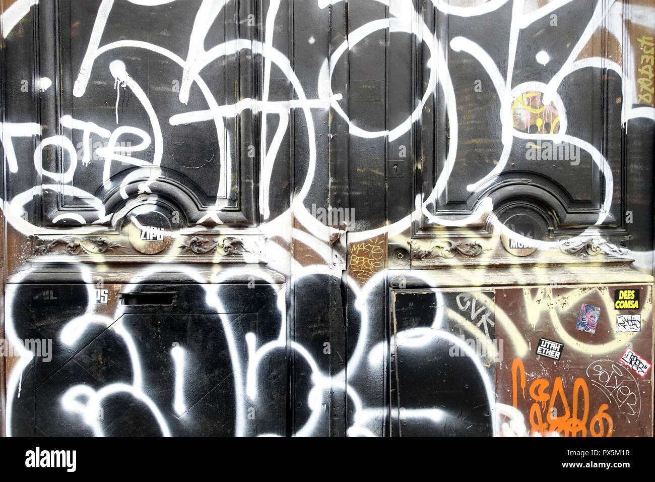 Graffiti on a door.  Paris. France. Stock Photo