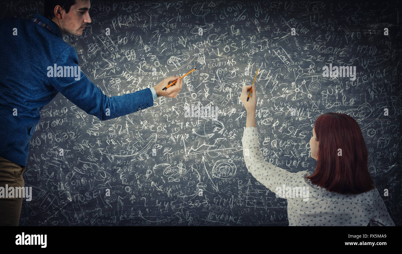 Man and woman sharing thoughts together solve difficult tasks on blackboard. Idea exchange, hard mathematics calculation. Business project planning co - Stock Image