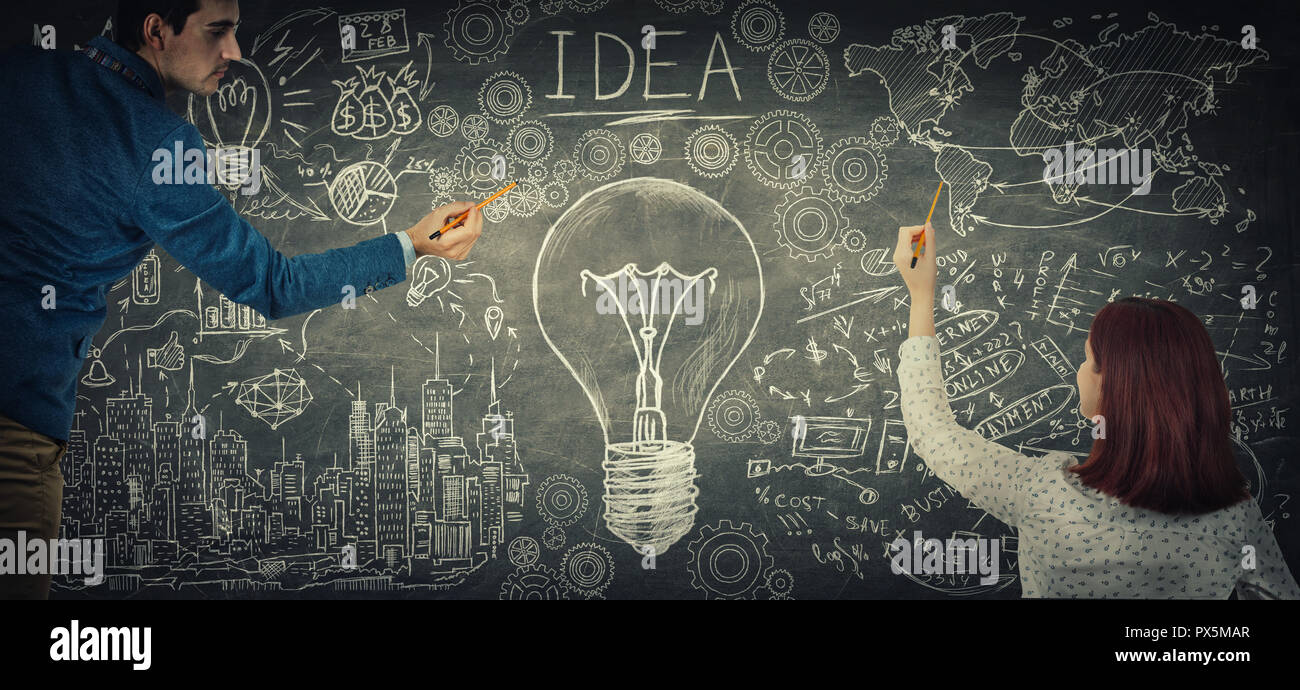Man and woman sharing thoughts together drawing a big light bulb sketch on blackboard. People ideas exchange, business partnership and teamwork innova - Stock Image
