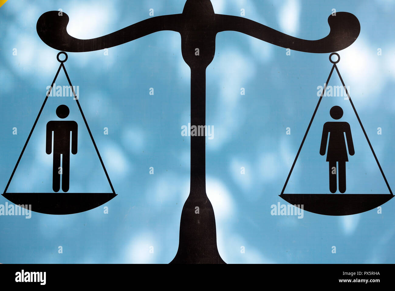 Male and female figures on scale. Gender equality.  Vung Tau. Vietnam. - Stock Image