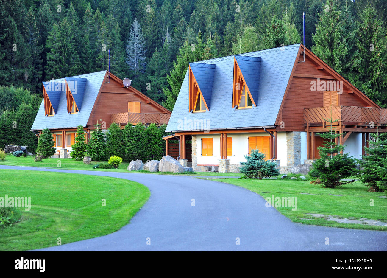 Two country houses in slovak village, Donovaly, Tatras - Stock Image