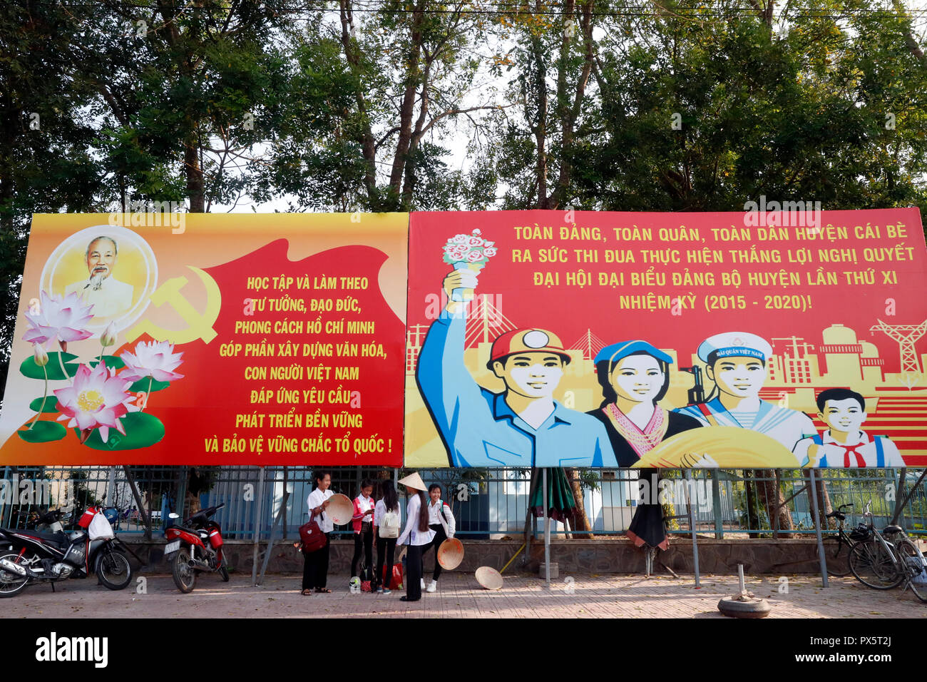 Communist government propaganda poster in the street. Cai Be. Vietnam. - Stock Image