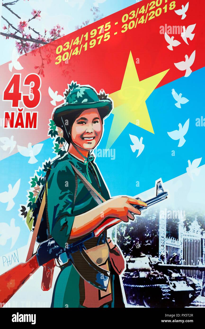 Communist government propaganda poster in the street. Dalat. Vietnam. - Stock Image