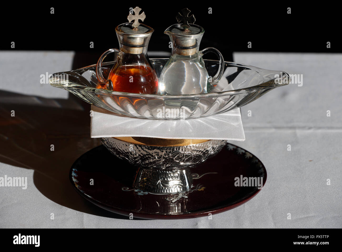 Hai Son Catholic church. Eucharist table with the liturgical items.  Pair of cruets.  Ba Ria. Vietnam. Stock Photo