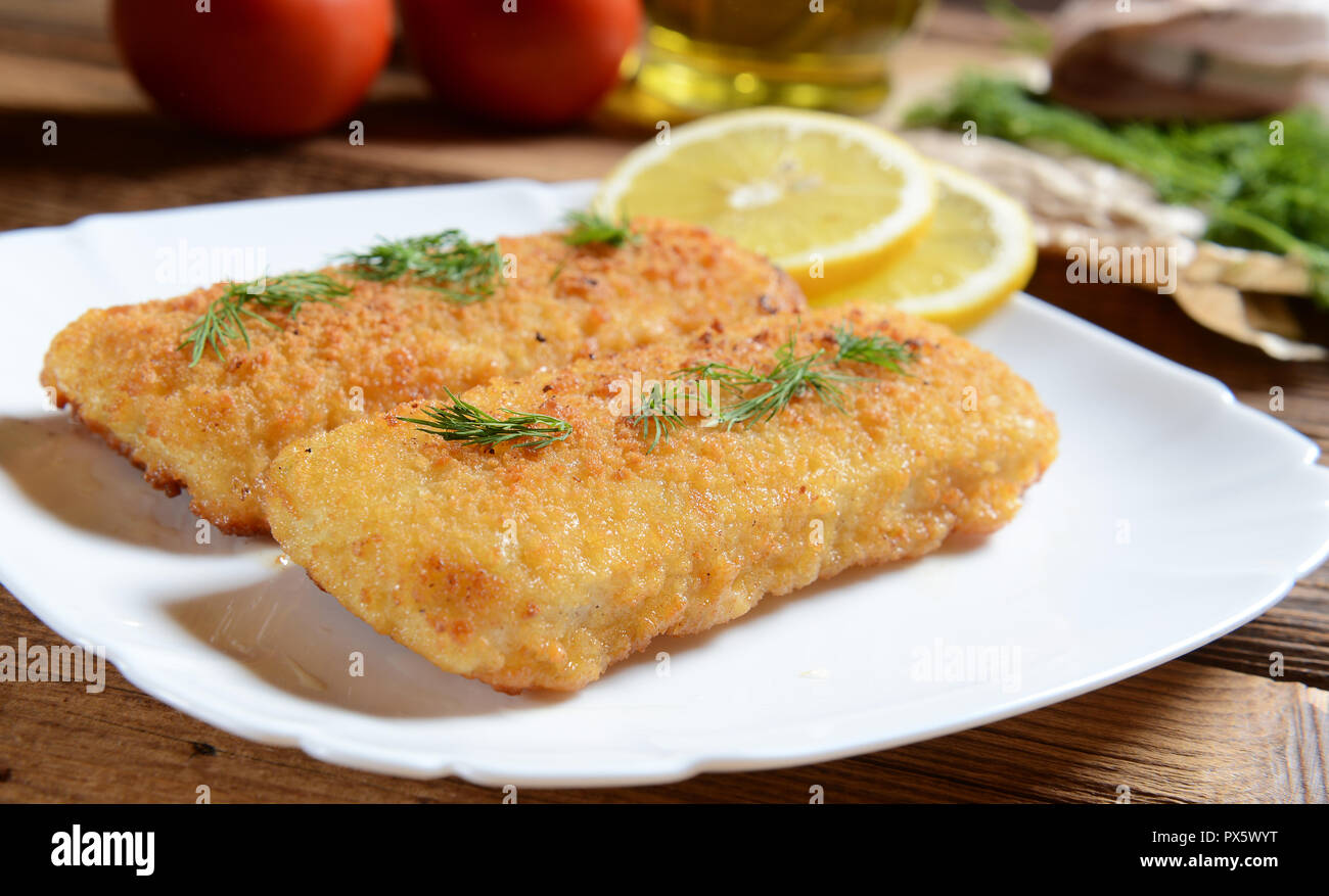 Fish fillets with chese - Stock Image
