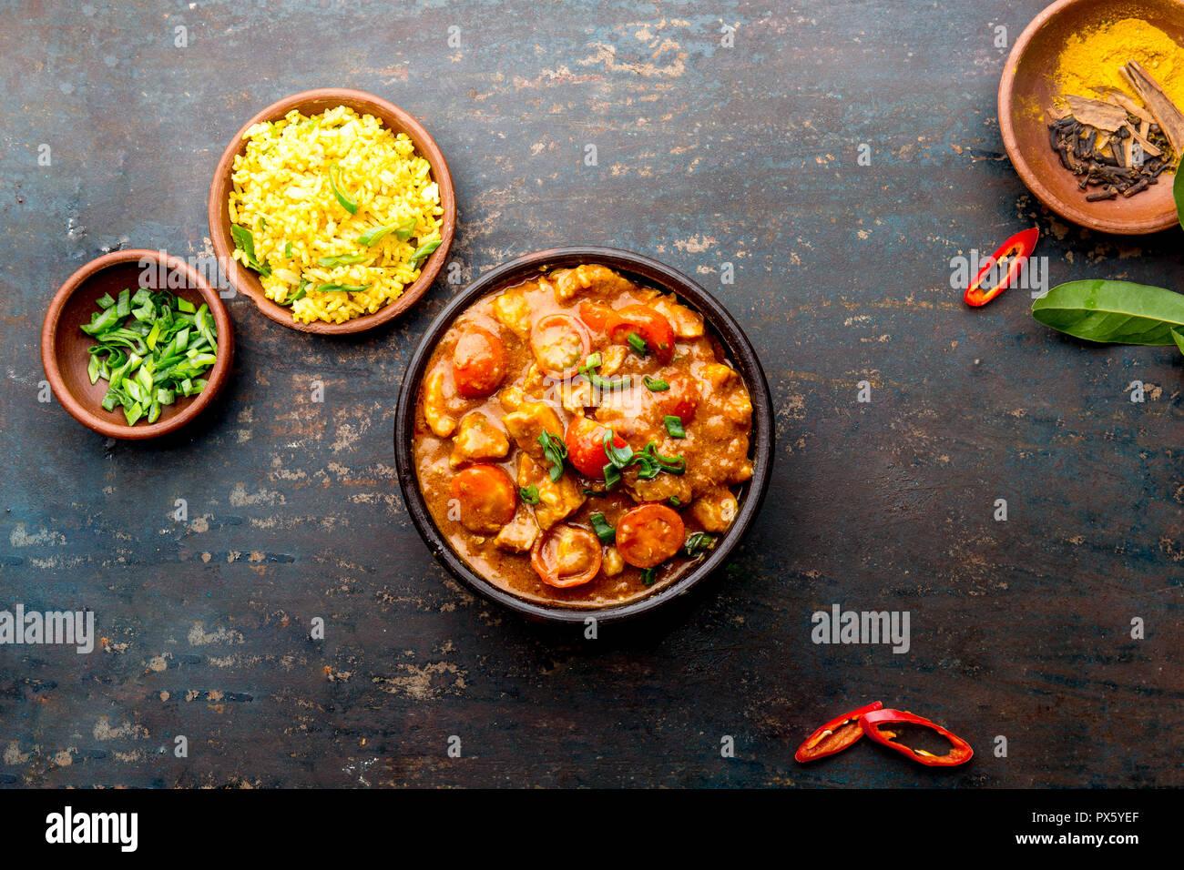 INDIAN FOOD. ROGAN JOSH curry sauce. Pork rogan josh with rice - Stock Image