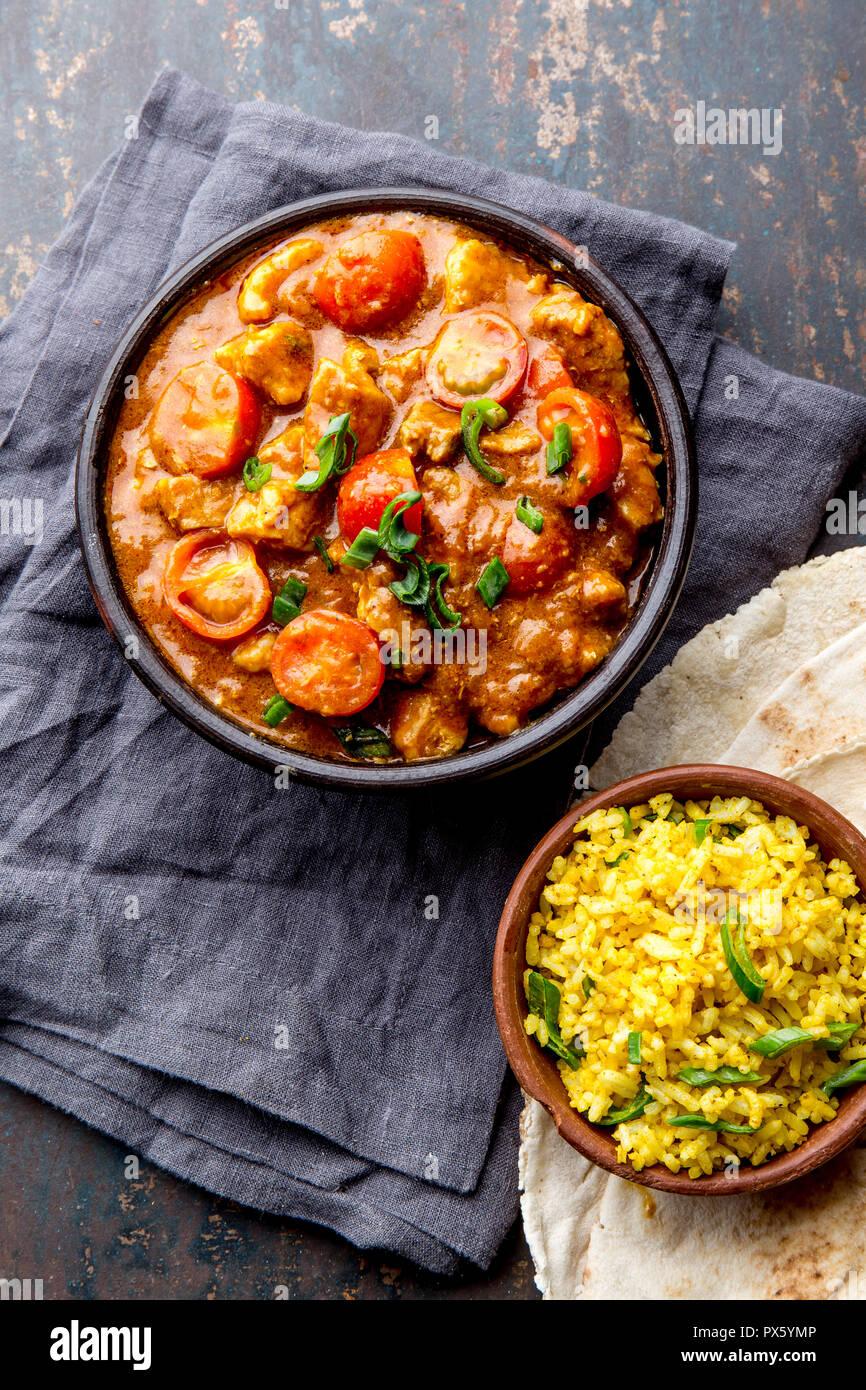 INDIAN FOOD. ROGAN JOSH curry sauce. Pork rogan josh with rice and naan bread - Stock Image