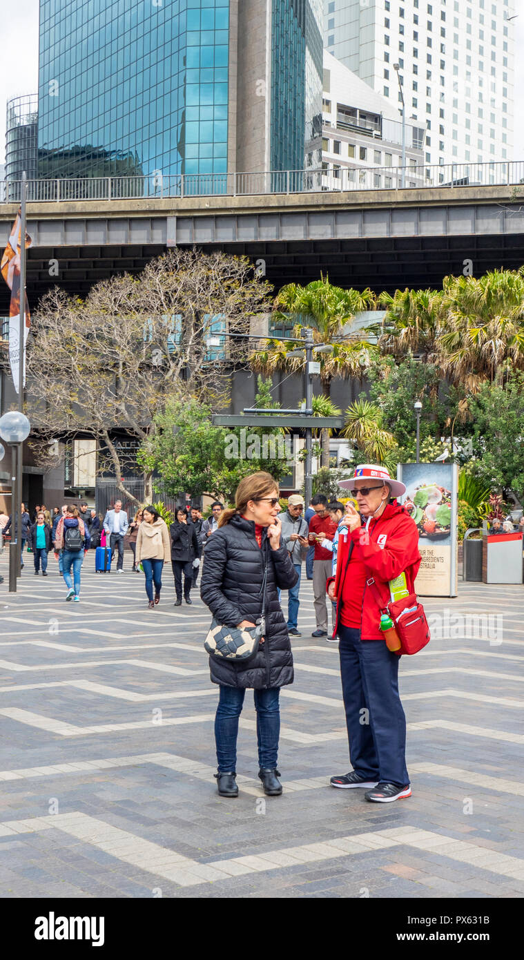 A guide giving advice to a tourist at Circular Quay and The Rocks area Sydney NSW Australia. - Stock Image