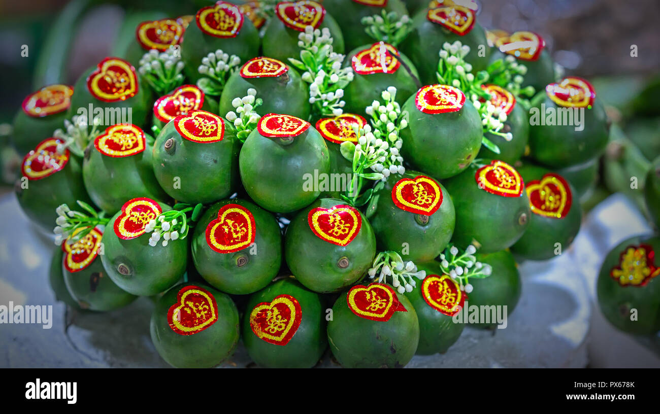 A buch of areca nut is bundled into bundles and decorated with beautiful patterns used to display fruit tray on the wedding day - Stock Image
