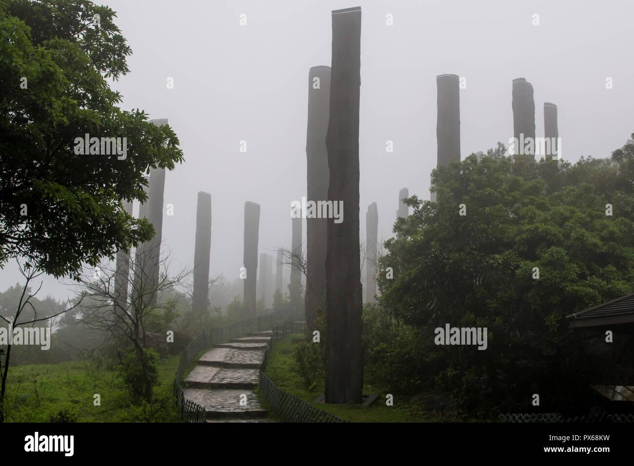 Tall wooden steles at the Wisdom Path, Lantau Island, Hong Kong, China. - Stock Image