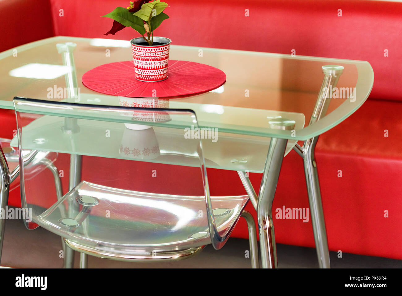 Red sofa and transparent table with flower in waiting area ...