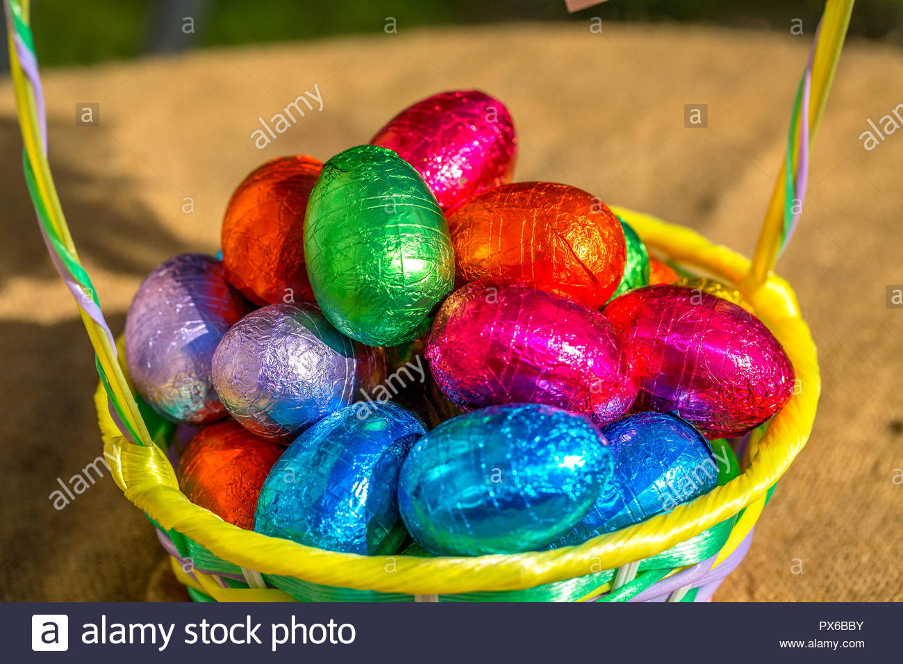 Basket of Multi-Colored Easter eggs - Stock Image