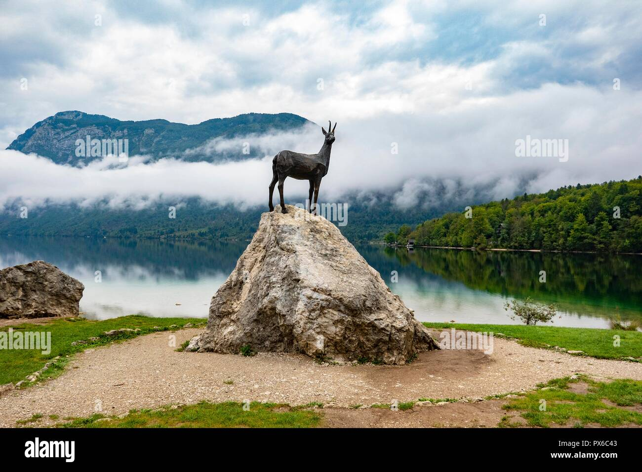 Slovenia, Bohinjskao-Lake, Ribcev Laz,09.15.2018. Statue of the mystical deer Zlatorog (Goldhorn) at the lakeside reminds of a well known fairy tale - Stock Image