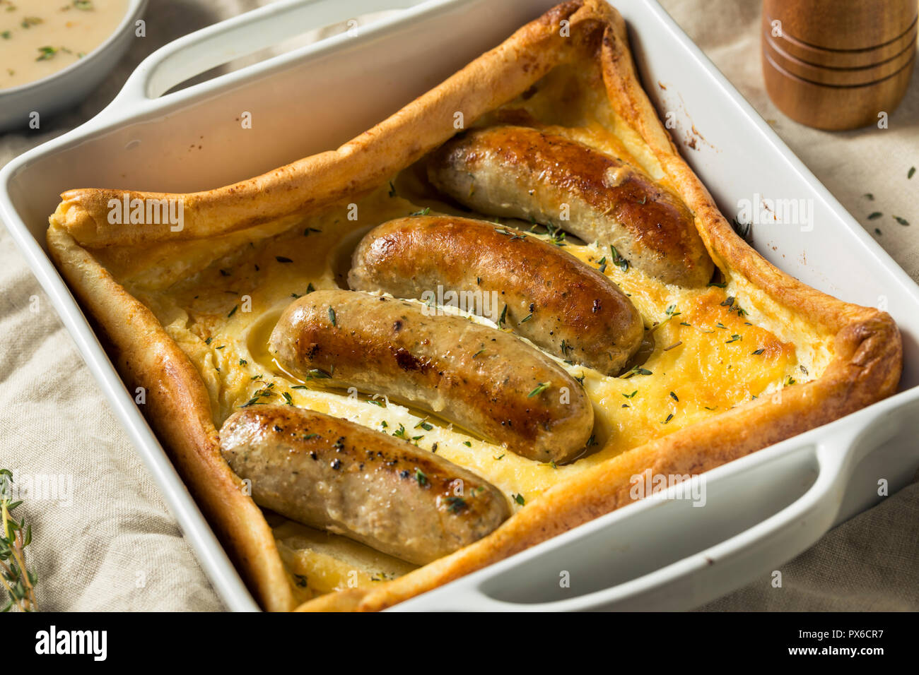 Homemade English Toad in the Hole Ready to Eat - Stock Image