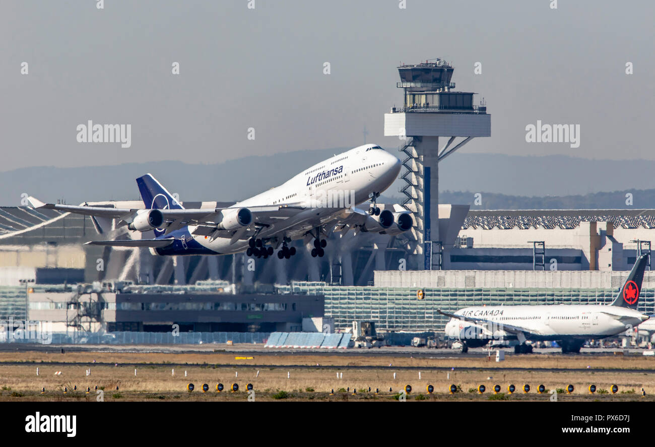 Frankfurt / Main Airport, FRA, Fraport, Air Traffic Control Tower, Lufthansa Boeing 747 at take-off - Stock Image