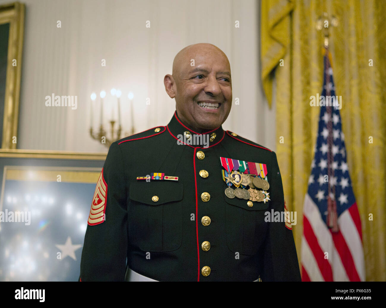 Medal of Honor recipient retired U.S. Marine Sgt. Maj. John Canley smiles during the presentation rehearsal in the East Room of the White House October 17, 2018 in Washington, DC. Canley received the nations highest honor for actions during the Battle of Hue in the Vietnam War. Stock Photo