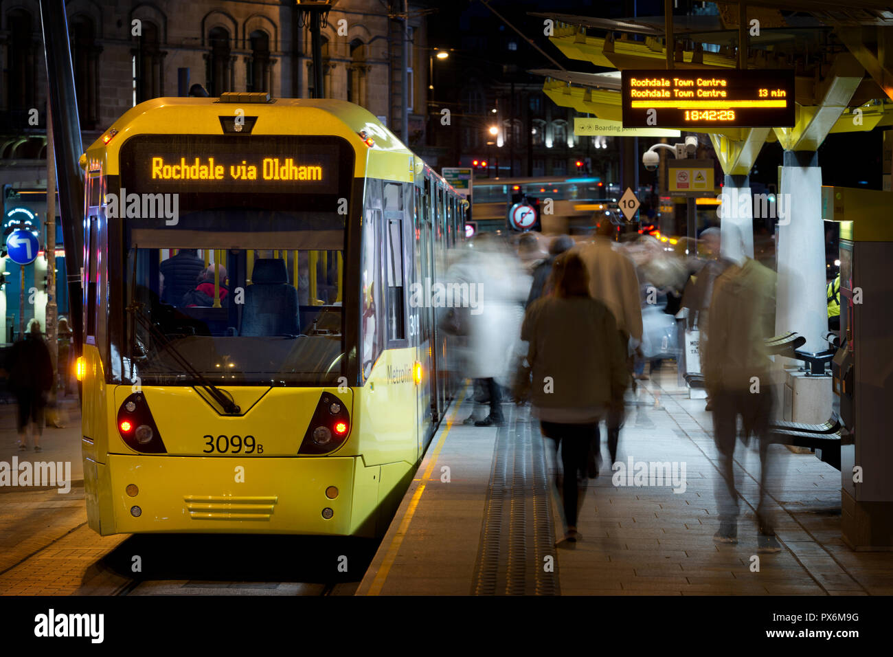 A Metrolink tram bound for Rochdale via Oldham arrives at the Echange Square stop in Manchester City Centre, UK. - Stock Image