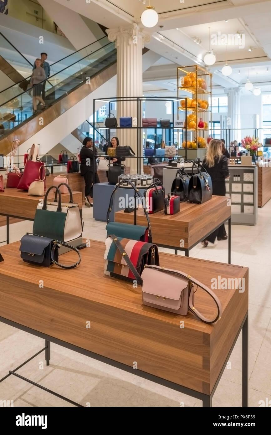 Upmarket handbags on display in Selfridges Department Store, London, England, UK - Stock Image