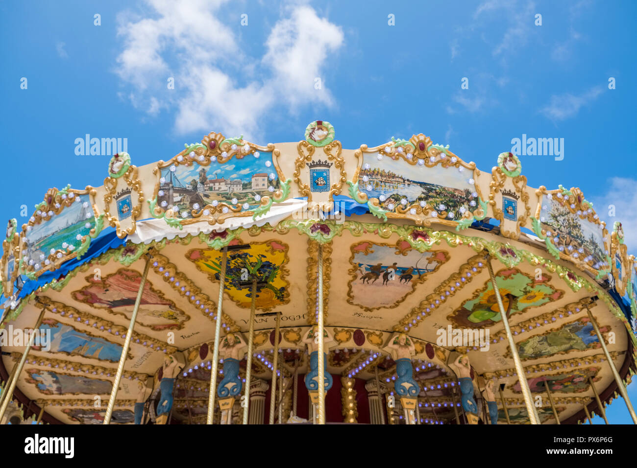 Carousel roundabout canopy against blue sky - Stock Image
