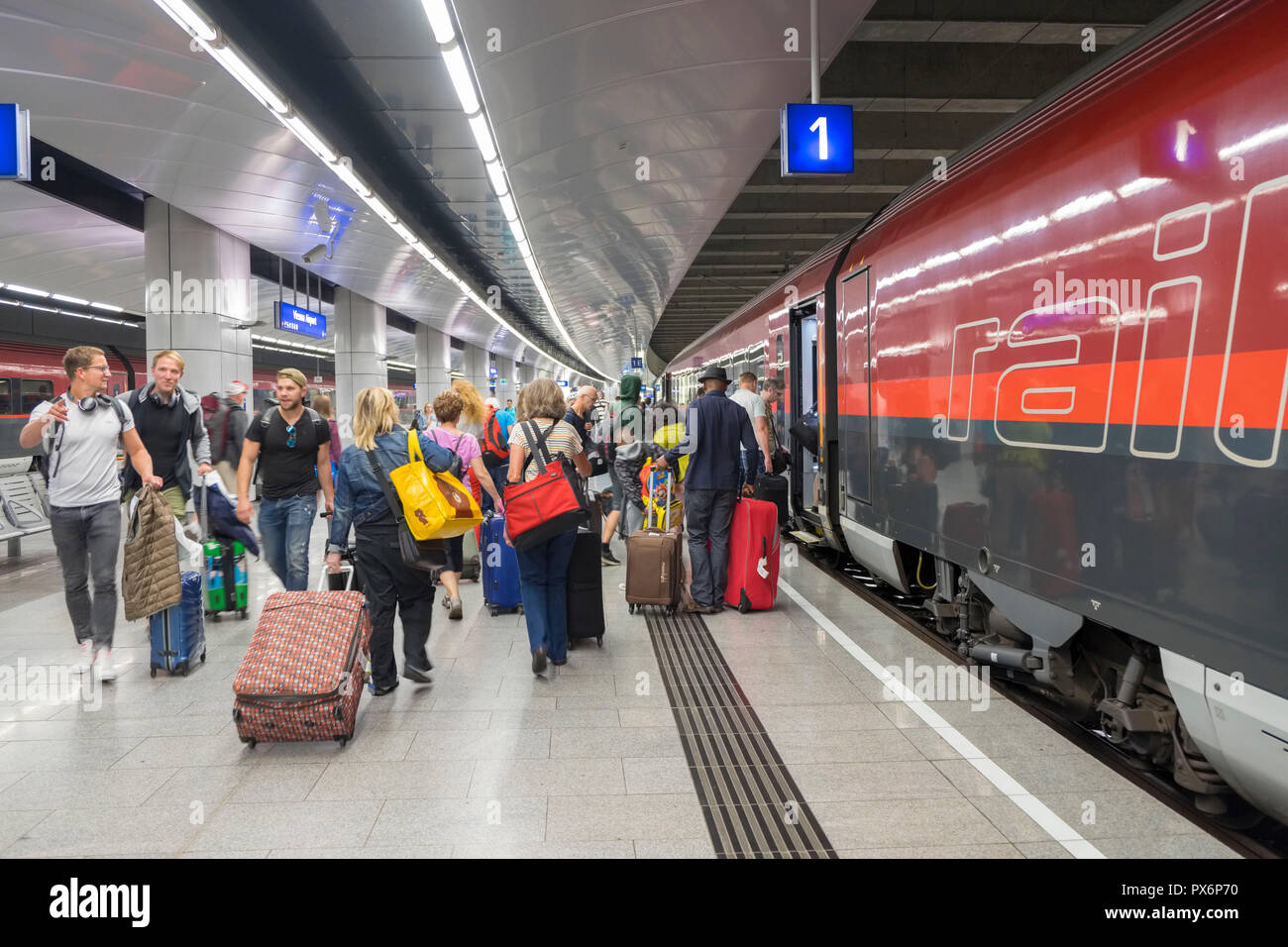 Passengers boarding a train in Vienna, Austria, Europe - Stock Image