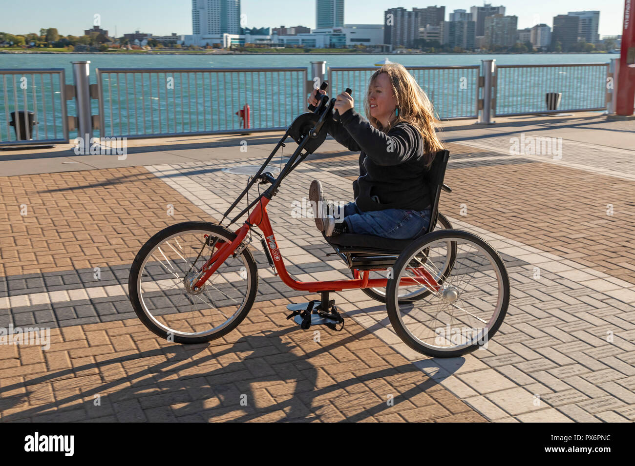 Detroit, Michigan - People try out adaptive bicycles, now offered through MoGo, Detroit's bike share system. The adaptive bikes are designed for peopl Stock Photo