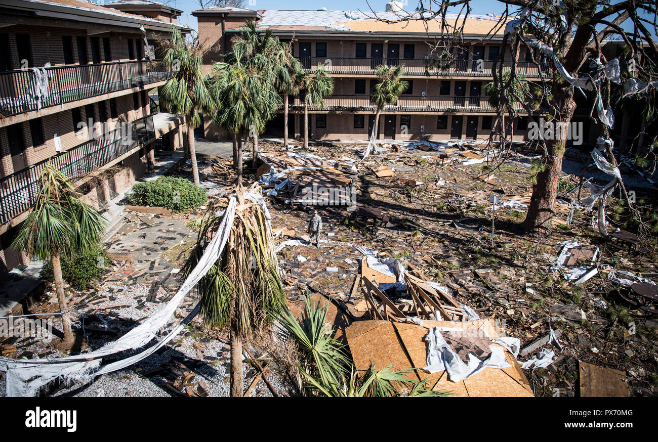 Airmen view the damage to airmen dormitories at Tyndall Air Force Base in the aftermath of Hurricane Michael as the storm left a swath of destruction across the Panhandle region of Florida area October 17, 2018 near Panama City, Florida. The Category 4 monster storm left behind catastrophic damage along northwestern Florida. - Stock Image