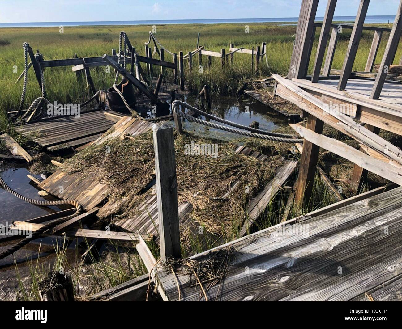Catastrophic damage to a dock in the aftermath of Hurricane Michael as the storm left a swath of destruction across the Panhandle region of Florida area October 11, 2018 in Keaton Beach, Florida. The Category 4 monster storm left behind catastrophic damage along northwestern Florida. - Stock Image