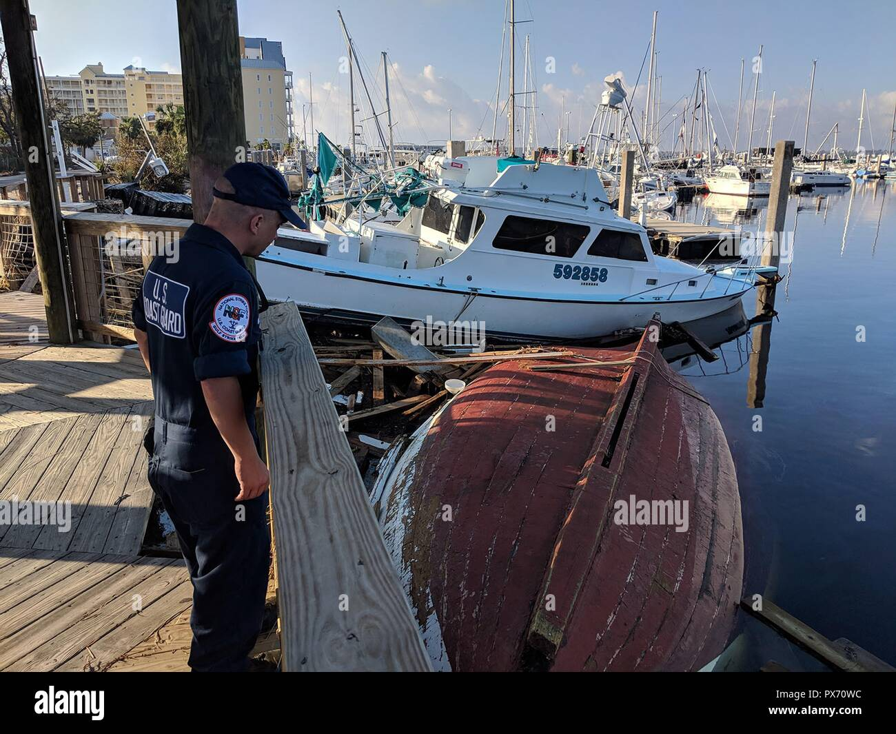 Catastrophic damage to a docks, boats and the marina in the aftermath of Hurricane Michael as the storm left a swath of destruction across the Panhandle region of Florida area October 15, 2018 in Panama City, Florida. The Category 4 monster storm left behind catastrophic damage along northwestern Florida. - Stock Image