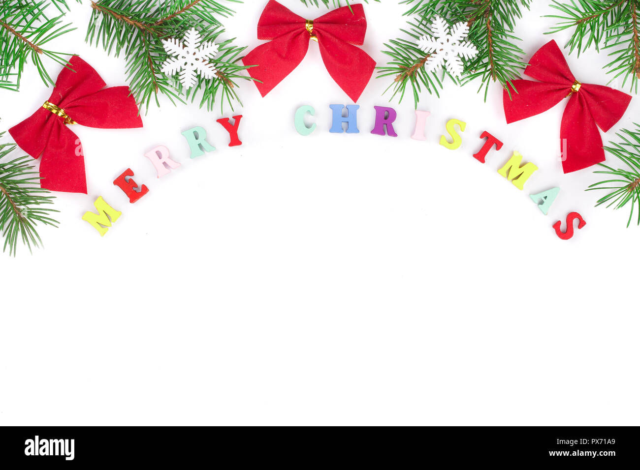 merry christmas inscription in frame made of fir branches, festive ...