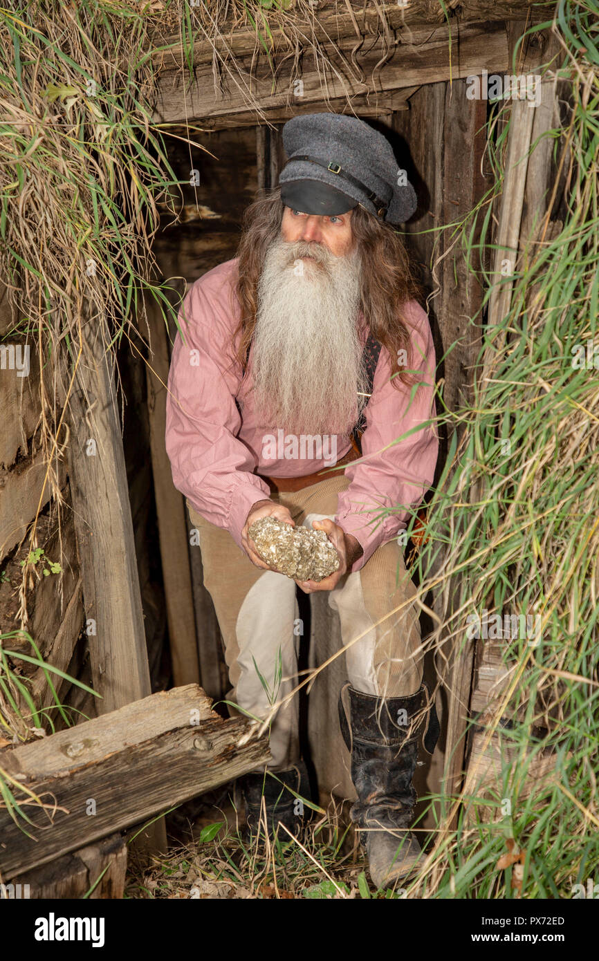 Old Prospector in a mine in South Dakota - Stock Image