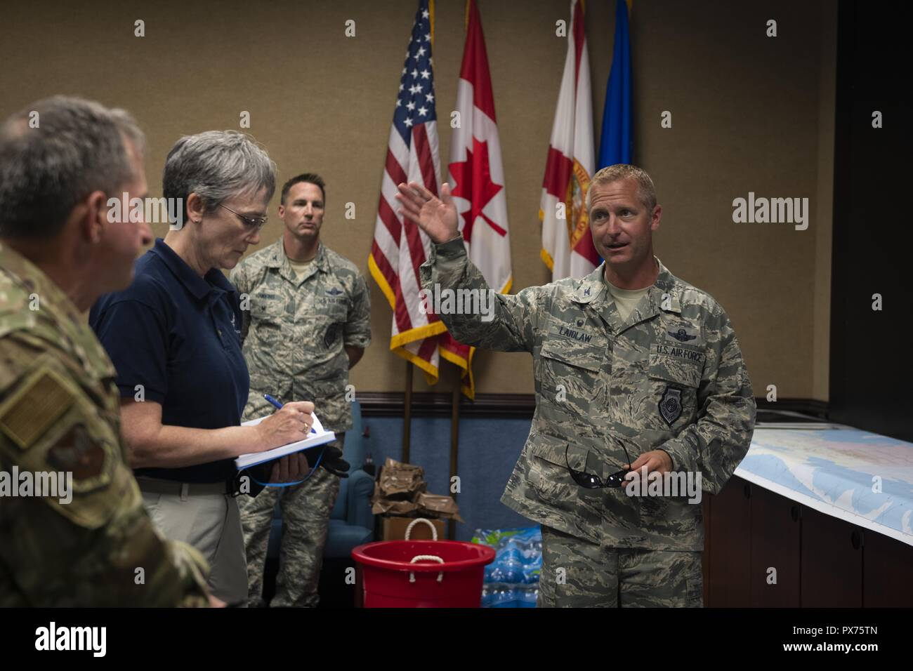 U.S. Air Force Col. Brian Laidlaw, right, commander of the 325th Fighter Wing, briefs Air Force senior leaders on the status of personnel and supplies at Tyndall Air Force Base, Florida, Oct. 14, 2018, October 14, 2018. Air Force senior leaders toured Tyndall Air Force Base to assess the damage from Hurricane Michael, one of the most intense tropical cyclones to ever hit the U.S. (U.S. Air Force photo by Senior Airman Joseph Pick). () Stock Photo
