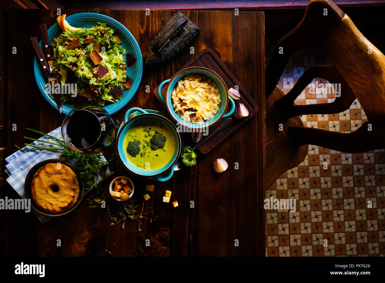 Rustic dinner set with healthy broccoli cream soup, salad