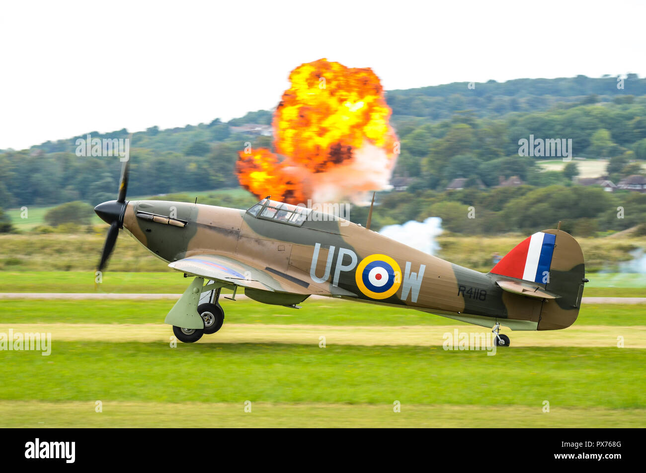 Hawker Hurricane Second World War fighter plane taking off at Shoreham Airshow with explosion during Battle of Britain scramble scenario. RAF - Stock Image