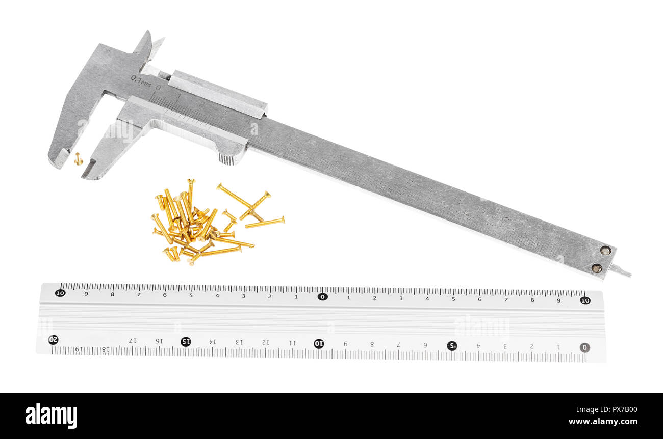 old steel callipers, metallic ruler and lot of brass screws isolated on white background - Stock Image