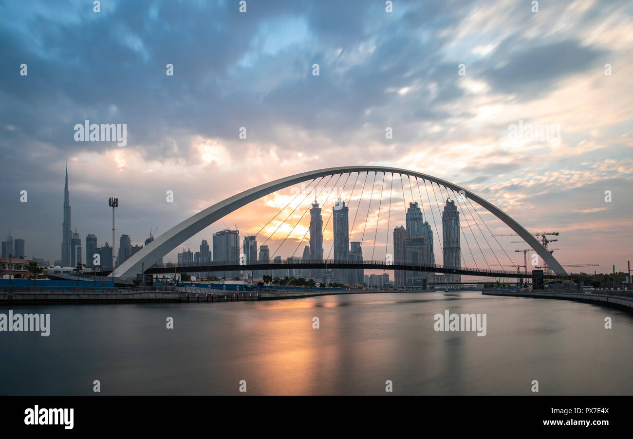 Dubai, United Arab Emirates, 20th october 2018: Tolerance bridge at Dubai waterway at sunrise - Stock Image
