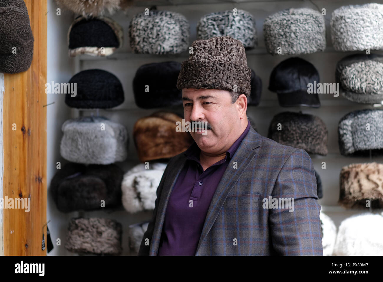 An Uzbek man wearing a Karakul or qaraqul hat traditionally made from the  wool of the karakul sheep in the city of Bukhara in Uzbekistan 14bf676431a5