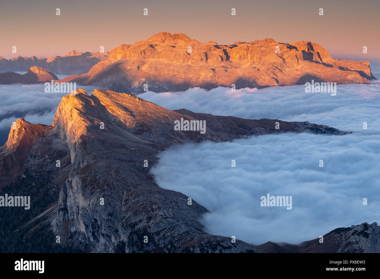 The Sella mountain group at sunrise. Tide of clouds. The Dolomites - Stock Image