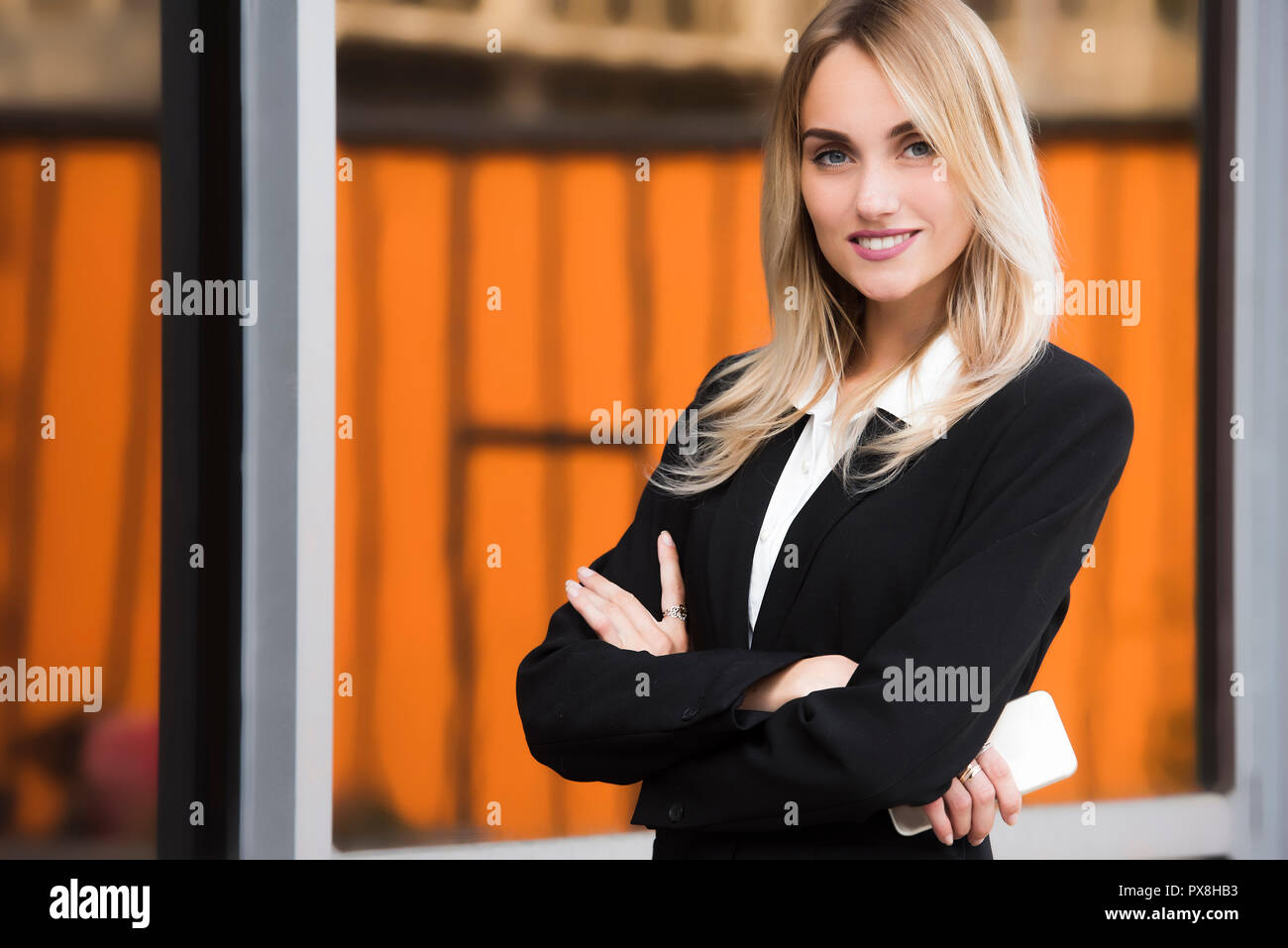 close up portrait of a young business woman executive - Stock Image