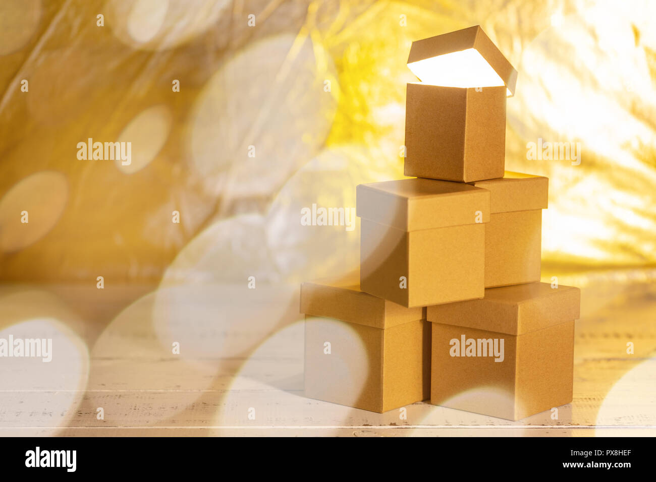 Small Cardboard Gift Boxes With Bokeh Effect As Concept Of Christmas